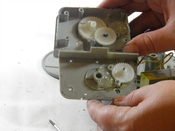 Carefully pull apart the gear housing's panels.