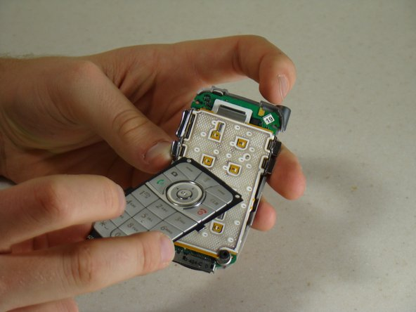 Image 3/3: Lift the silicone keypad cover off.