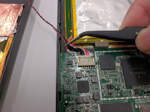 Locate the two wires connecting the speaker to the motherboard.