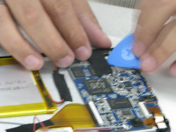 Image 1/1: Be careful not to rip or damage the tape or else new tape will have to be used for the new motherboard.