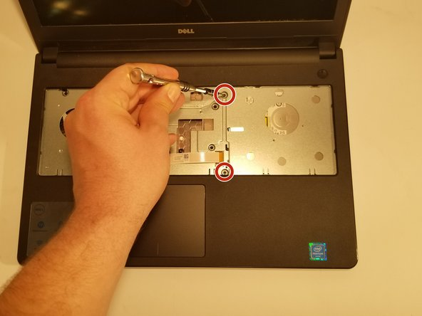 Next using the J0 bit tipped screwdriver unscrew the 2 remaining screws shown in the picture.