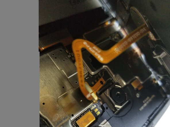 when there is enough glass Separating, begin to lift it slowly. There is a cable connecting your finger print sensor to the board. BE SURE NOT TO TEAR THIS