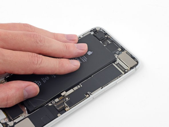 Be sure to hold down the battery as you remove the final strip, or it may fling out of the iPhone unexpectedly.