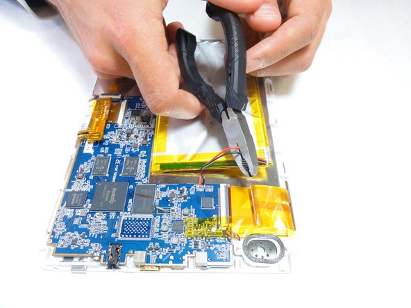 Cut the pos(+) and neg (-) wires that connect the battery to the device using wire cutters.