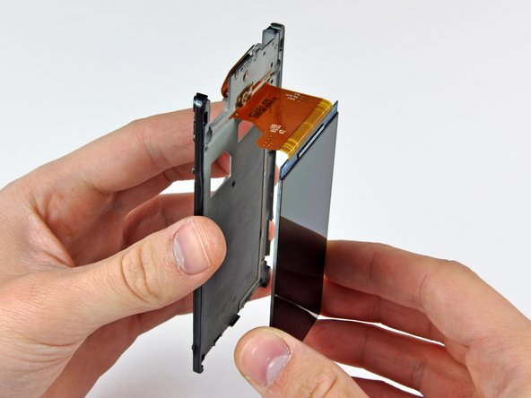 Carefully de-route the display data cable through the inner chassis and remove the OLED display.