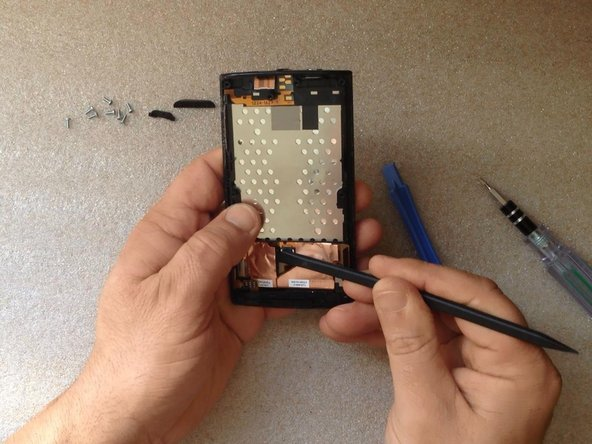 Unstuck the Touchscreen flex cable from the LCD Display Frame.