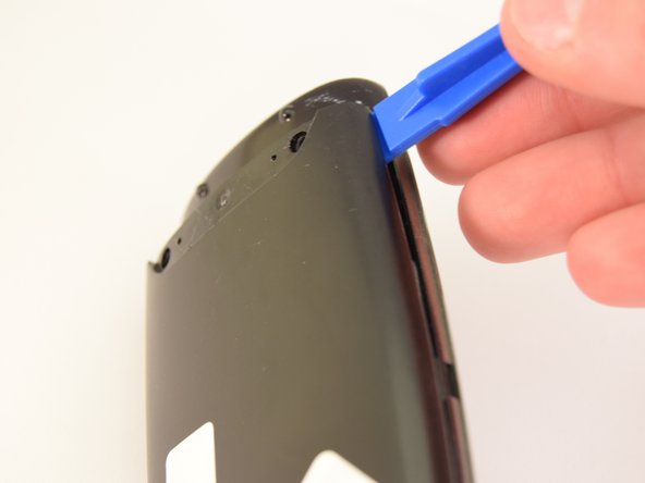 Using a plastic opening tool, pry the case off starting from the top of the device (nearest the transmitter). There are 3 tabs along the side of the case and one at the back.