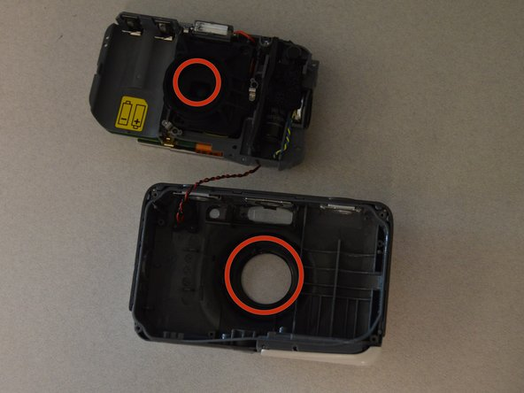 Wipe the lens and the clear plastic on the front case to remove debris.