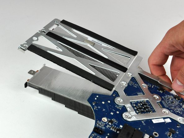 Lift the logic board off the heat sink.