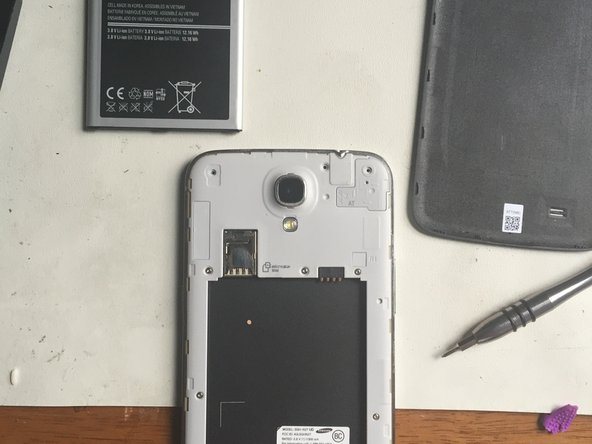 Proceed to remove all PH000 screws from the exposed area as shown.