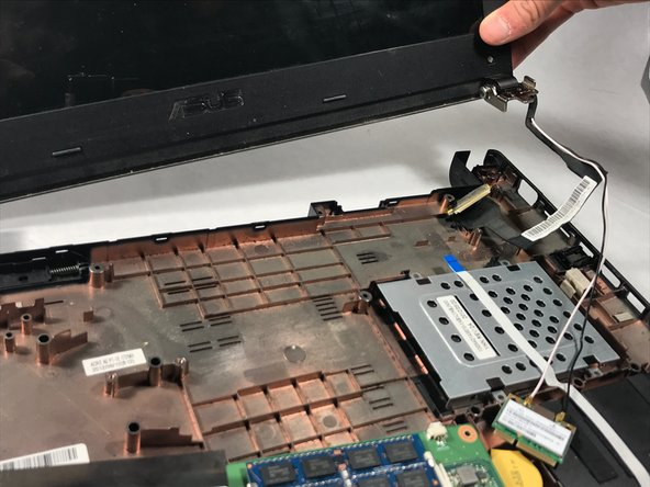 Once both sides of the laptop are unscrewed, gently pull the upper half of the laptop off of the bottom half.