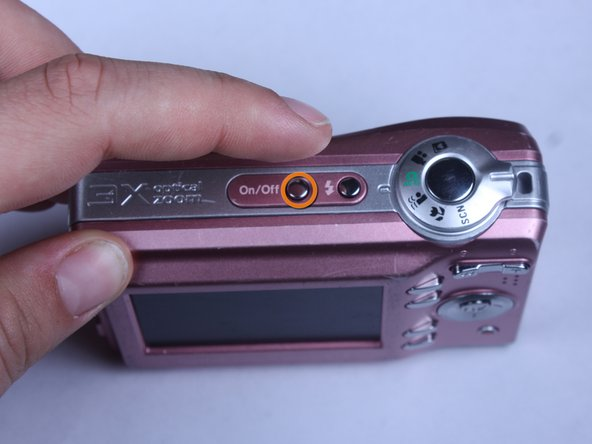 Turn the camera off by firmly pressing the power button located on top of the camera.