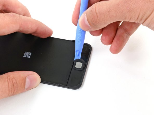 Use a plastic opening tool to pry the rubber membrane up from around the home button.