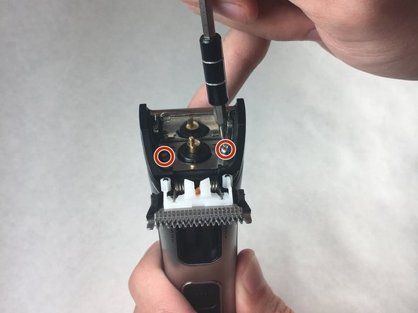 Remove two screws (M2 x 9.5) on metal plate with JIS 0 screwdriver bit.