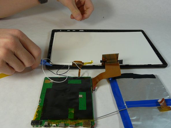 Using a plastic opening tool, remove the back screen pieces from the back.