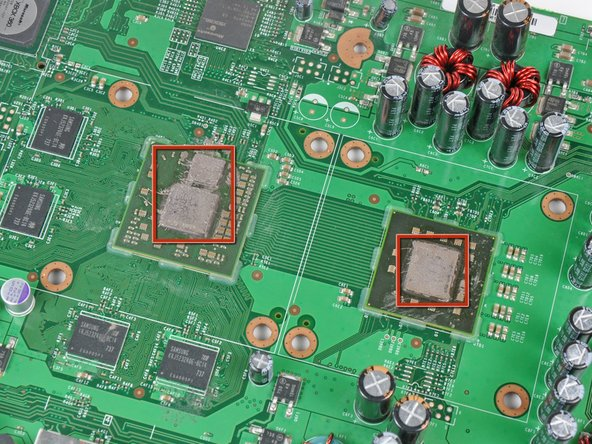 Image 2/2: Work slowly as you remove the old residue, as many sensitive components are soldered near the processors. If damaged, you may need a whole new motherboard