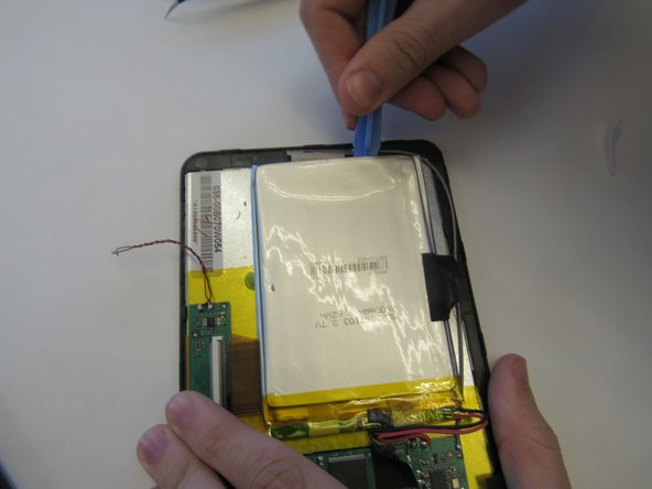Remove the battery pack by carefully prying the battery back from the front cover. Then remove the wires connecting the battery to the motherboard at the motherboard using the tweezers.
