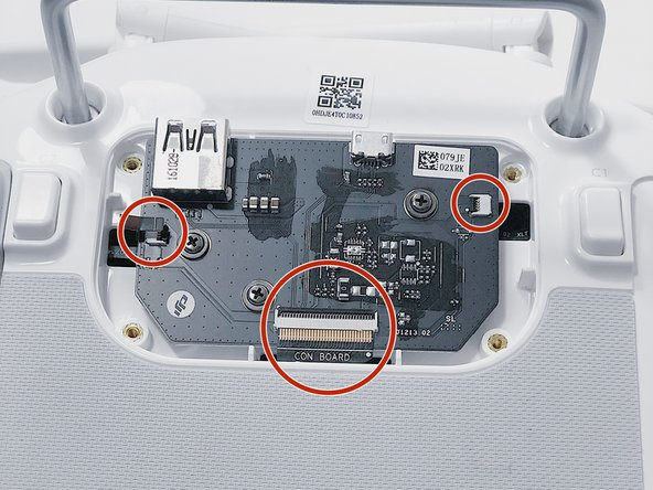 Remove each of the three ribbon cables from their tabs by pulling in a horizontal direction away from the socket.