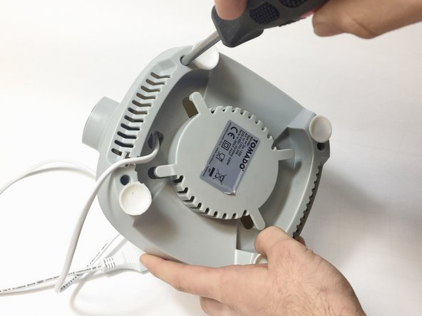 Remove the base of the blender by removing the 4 screws at underneath..