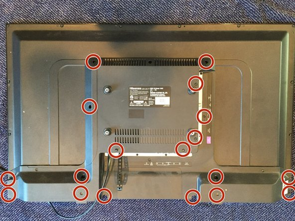 To begin removing the back plate, find and remove all 18 screws indicated with the Phillips screwdriver.