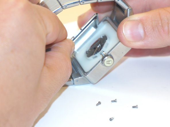 Gently lift the back plate, and be careful to not damage the rubber gasket.