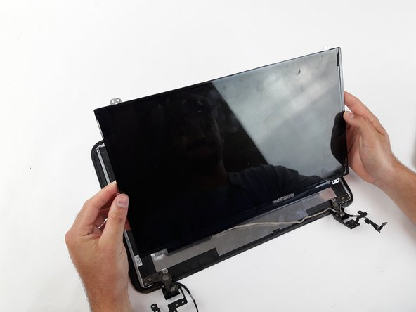 Remove the screen from it's case.