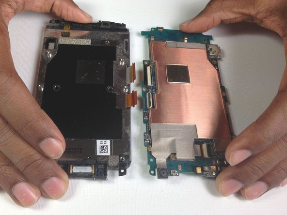 Image 2/2: If there is resistance pulling apart the phone then a ribbon or tab has not been disconnected properly/completely.