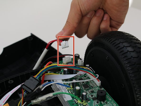 Remove one connector from the non-battery side circuit board.
