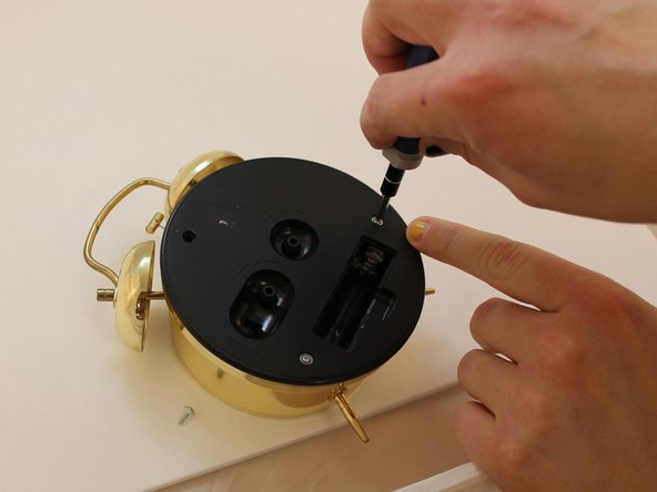 Then remove the three screws on the back cover using a philips screwdriver #1.