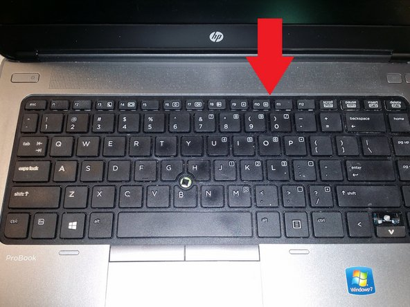 Take a spudger tool and pry the keyboard down toward the mouse pad and up toward you. After you raise the keyboard there are tabs at the bottom. Pull the keyboard away from you, and it will dislodge.