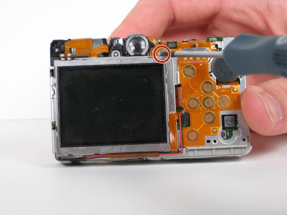 Remove the one 2.4 mm Phillips screw directly above the top right corner of the LCD screen.