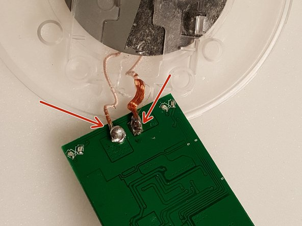 The charging unit is soldered to the back of the circuit board.  (see photo)