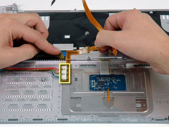 Image 1/1: Carefully peel up the orange ribbon cable removing tape as necessary.