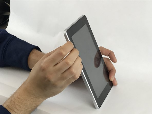 Hold the device by the silver edge and the front of the screen.