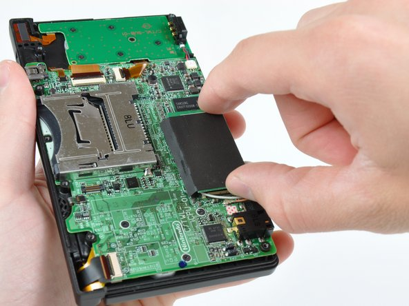 Pull the Wi-Fi board away from the motherboard by its edge closest to the headphone jack.