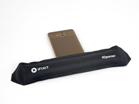 Heat an iOpener and apply it to the bottom edge of the phone for two minutes. Re-heat the iOpener as needed.