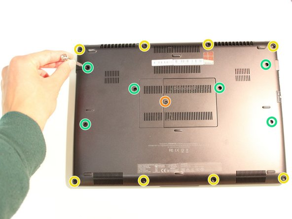 Remove all 15 marked screws on the underside of the laptop using a #0 screwdriver.