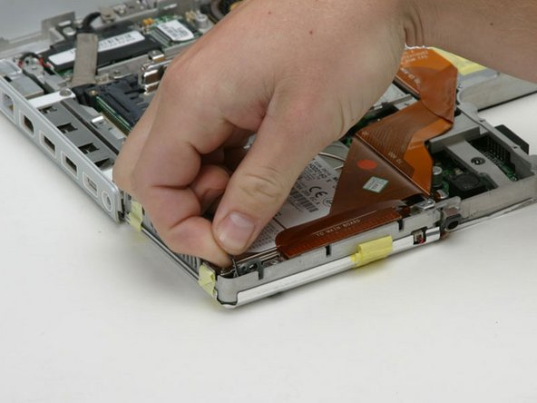 If you have already removed the hard drive in a previous step, your iBook may differ slightly from the picture.