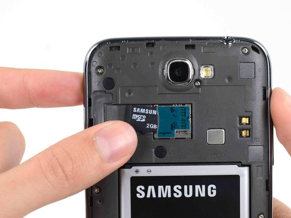 Image 3/3: For reassembly, push the microSD card into the slot until it clicks in place.