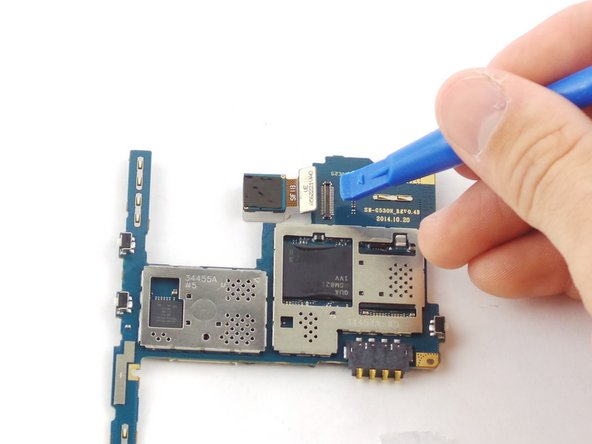 Remove the motherboard and unhook the ribbon cable clip to the back camera