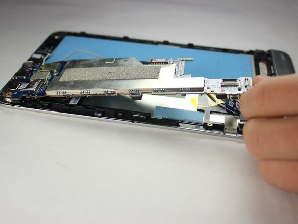 Lift the motherboard out of the tablet's case.