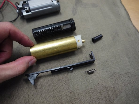 Remove the entire piston and cylinder assembly with the tappet plate, tappet plate spring, and air nozzle.