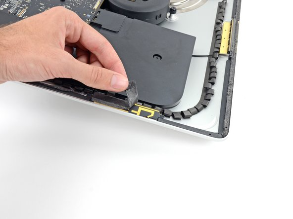 Remove all of the remaining adhesive strips from the iMac's frame and display glass.