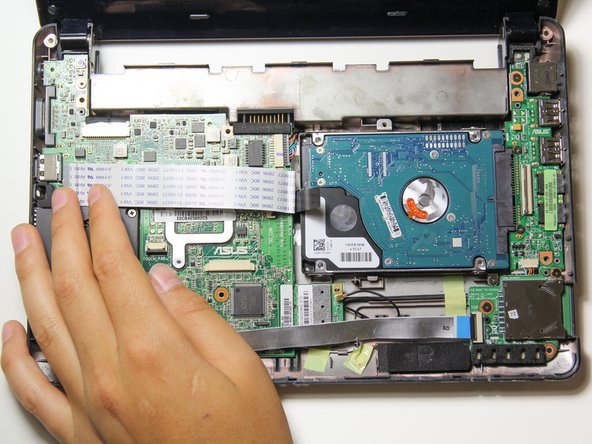 Fold over the ribbon cable to the left side of the hard drive.
