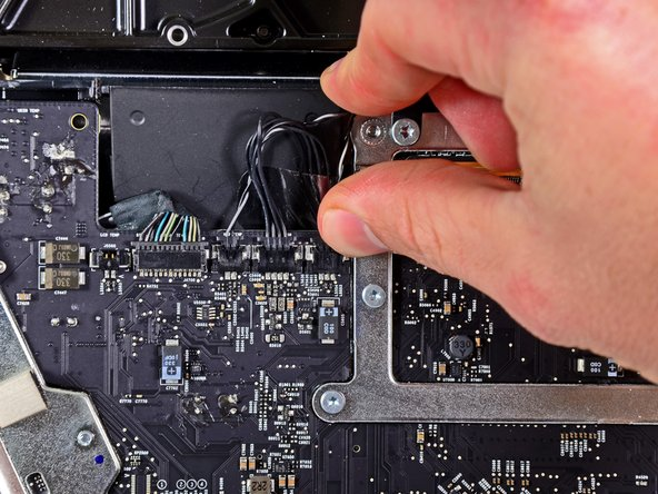 Pull the optical drive thermal sensor connector toward the top edge of the iMac to disconnect it from its socket on the logic board.