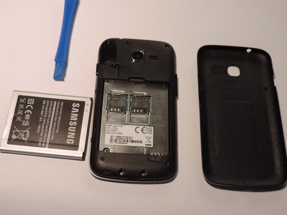 Once rear cover is off use small pastic spudger to lift battery out of the phone