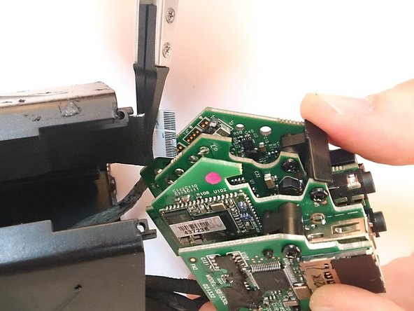 Image 1/3: To take out the stack of PCBs, first, disconnect the flex connector with tweezers.