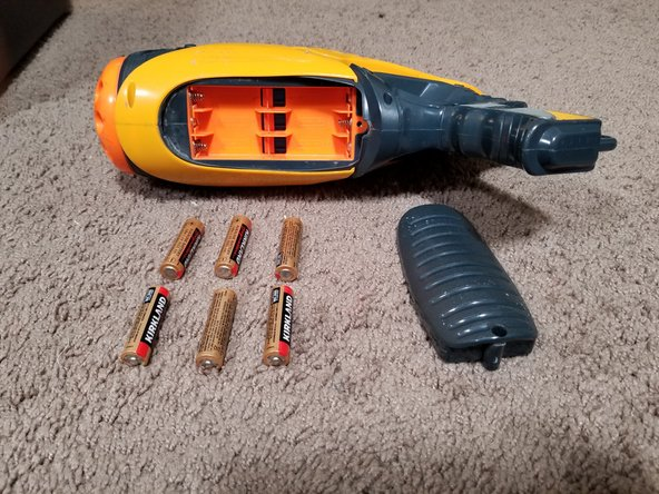 Remove the battery case using the Phillips head screwdriver and take out the batteries. You want to do this just in case something in the electronics goes haywire.