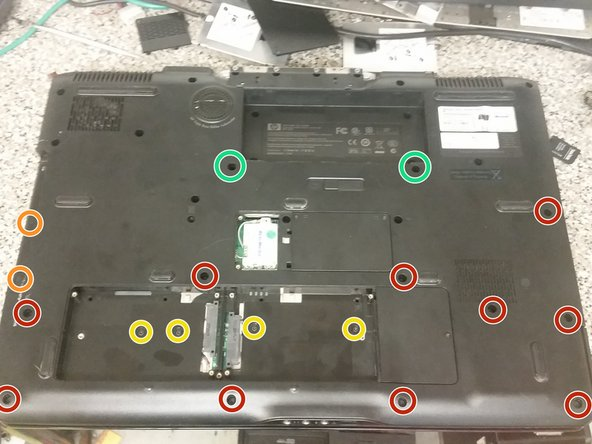 Flip the laptop upside-down again, and remove the ten M2.5x8 screws securing the palmrest to the base.