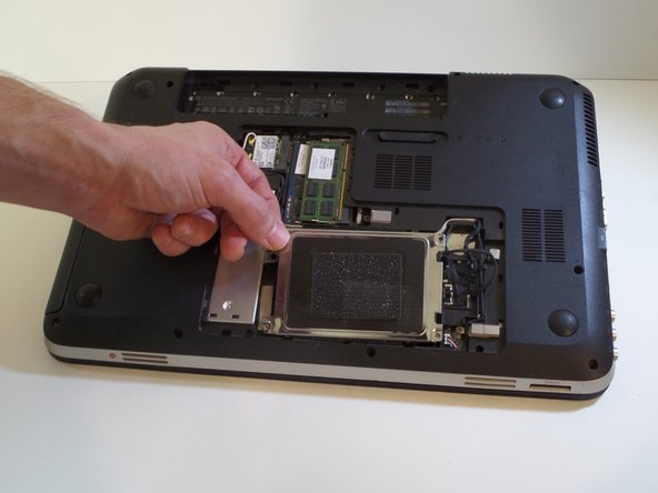 Lift the corner bracket to remove the hard drive.